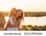 family  mother and daughter on... | Shutterstock . vector #1021959604
