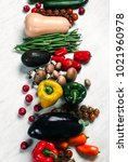 Small photo of a variety of fresh Vegetables background on a white marble table. place for writing text copy space. Agrarian market of home organic production. harvesting