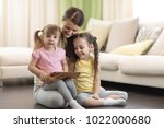 cute mom with her 2 years old... | Shutterstock . vector #1022000680