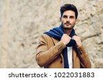 young man wearing winter... | Shutterstock . vector #1022031883