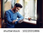 young smiling man with blue... | Shutterstock . vector #1022031886