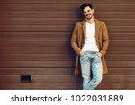 young smiling man wearing demi... | Shutterstock . vector #1022031889