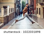young happy man jumping wearing ...   Shutterstock . vector #1022031898