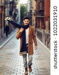 young man wearing winter...   Shutterstock . vector #1022031910