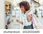young black woman in front of a ... | Shutterstock . vector #1022032600