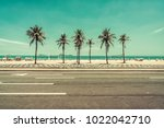 sunny day with palms on ipanema ... | Shutterstock . vector #1022042710
