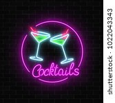 neon cocktails bar sign on dark ... | Shutterstock .eps vector #1022043343