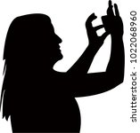 woman taking photo  silhouette... | Shutterstock .eps vector #1022068960