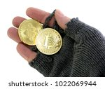 Small photo of concept of the risk of virtual currency with hand of poor man holding BitCoin coins on white background