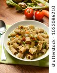 Small photo of vegetable minestrone with ingredients around - closeup