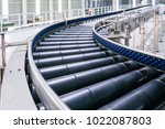 crossing of the roller conveyor ... | Shutterstock . vector #1022087803