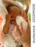 infant drinking milk from the... | Shutterstock . vector #1022090200
