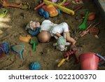 abandoned old children's toys... | Shutterstock . vector #1022100370