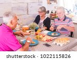 group of senior people having... | Shutterstock . vector #1022115826