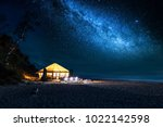 beach with glowing tent at... | Shutterstock . vector #1022142598