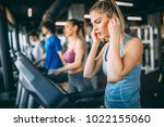 beautiful girl using treadmill... | Shutterstock . vector #1022155060