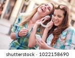 two beautiful young women... | Shutterstock . vector #1022158690