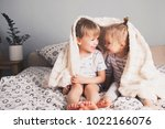 two pretty smiling kids embrace ... | Shutterstock . vector #1022166076