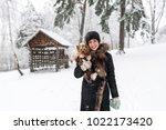 Woman Pet Owner In Black Coat...