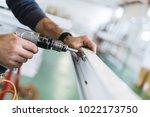manual worker assembling pvc...   Shutterstock . vector #1022173750