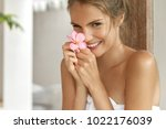 young cheerful female with... | Shutterstock . vector #1022176039