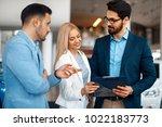 young couple choosing new car... | Shutterstock . vector #1022183773