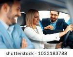 young couple choosing new car...   Shutterstock . vector #1022183788