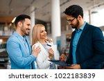 young couple choosing new car... | Shutterstock . vector #1022183839