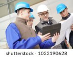 construction manager giving... | Shutterstock . vector #1022190628