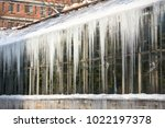 icicles hanging down from a...