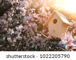Little birdhouse in spring over ...