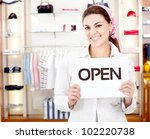 Female business owner opening a new retail store - stock photo