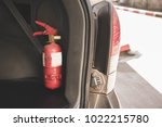 fire extinguisher in car | Shutterstock . vector #1022215780
