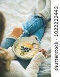 healthy winter breakfast in bed.... | Shutterstock . vector #1022222443