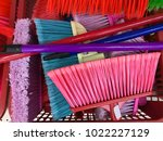 selection of new plastic brooms ... | Shutterstock . vector #1022227129