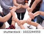 young people making circle with ...   Shutterstock . vector #1022244553