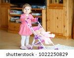 cute adorable baby girl making...   Shutterstock . vector #1022250829