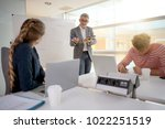 economics teacher giving... | Shutterstock . vector #1022251519