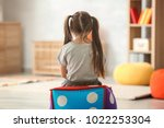 lonely little girl at home.... | Shutterstock . vector #1022253304