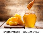 honeycombs and jar of honey on... | Shutterstock . vector #1022257969