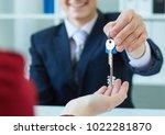 young male broker giving keys... | Shutterstock . vector #1022281870