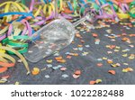 Small photo of Champagne glass with carnival decoration on a slate