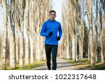 young sports man running in the ... | Shutterstock . vector #1022317648