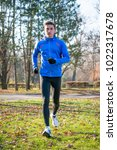 young sports man running in the ... | Shutterstock . vector #1022317678