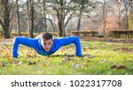 young male runner doing push up ... | Shutterstock . vector #1022317708