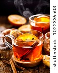 spicy citrus hot tea with... | Shutterstock . vector #1022336503