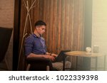 young manager working on laptop ... | Shutterstock . vector #1022339398