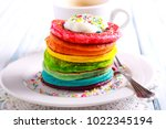 rainbow pancakes  served in... | Shutterstock . vector #1022345194