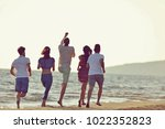 friends fun on the beach under... | Shutterstock . vector #1022352823