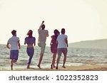 friends fun on the beach under... | Shutterstock . vector #1022352823